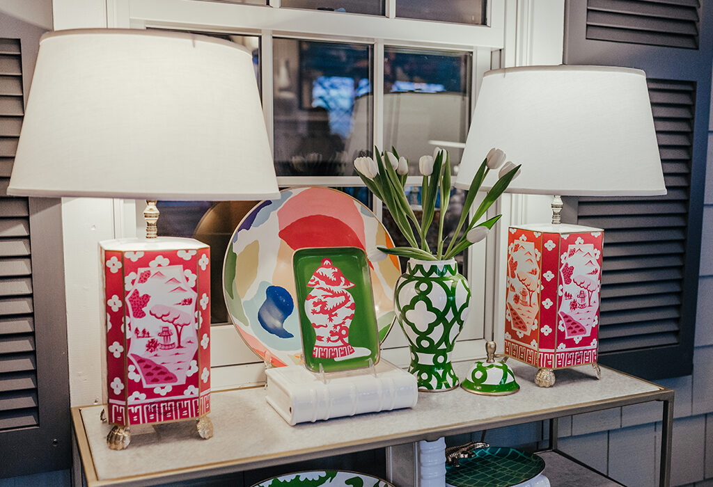 Two lamps are sometimes better than one.  These bright pink lamps act as bookends for the table and compliment the green and white accents.