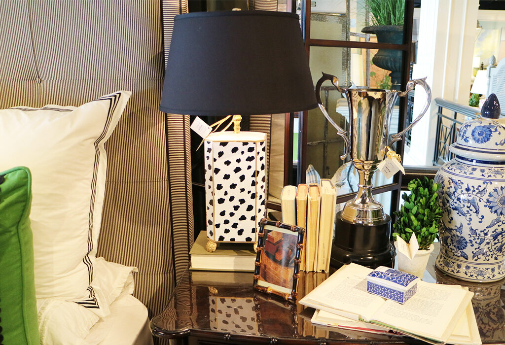 Patterned lamps bring a fun and powerful energy to any space.  Utilizing a lamp with a black shade is a nice venture from the classic white and really stands out.